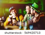 friends in irish bar | Shutterstock . vector #569420713