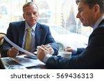 reading document | Shutterstock . vector #569436313