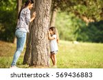 mother and daughter play hide... | Shutterstock . vector #569436883