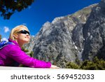 young woman hiker resting and... | Shutterstock . vector #569452033