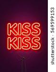 kiss kiss   neon sign a purple... | Shutterstock . vector #569599153