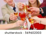 the clink of glasses. | Shutterstock . vector #569602003