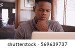 black guy working on his laptop | Shutterstock . vector #569639737