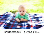 cute child baby boy lying on... | Shutterstock . vector #569651413