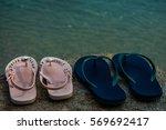 flip flops on a sandy ocean...   Shutterstock . vector #569692417
