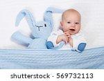 funny little baby wearing a... | Shutterstock . vector #569732113