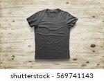 grey shirt over wood background | Shutterstock . vector #569741143