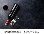 red wine glass and bottle on... | Shutterstock . vector #569749117