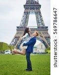 happy couple near the eiffel... | Shutterstock . vector #569786647