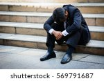stressed businessman sitting at ... | Shutterstock . vector #569791687