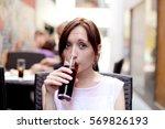 Girl Drinking Soda Sitting In...