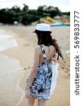 girl on the beach wearing a hat | Shutterstock . vector #569833777
