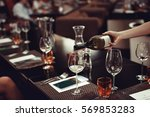 waiter pouring wine to the... | Shutterstock . vector #569853283