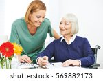 old woman in wheelchair doing... | Shutterstock . vector #569882173