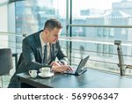 young businessman in suit... | Shutterstock . vector #569906347