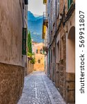 Small photo of Idyllic view of an narrow street alley in the old town of Soller, Spain Majorca.