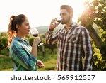 romantic couple in vineyard... | Shutterstock . vector #569912557