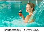 beautiful woman enjoying jet of ... | Shutterstock . vector #569918323