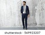 cool suit guy in studio | Shutterstock . vector #569923207