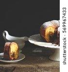 cocoa gugelhupf on old wooden... | Shutterstock . vector #569967433