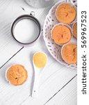 cornbread muffins and milk on... | Shutterstock . vector #569967523
