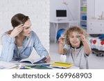 impatient mother doing homework ... | Shutterstock . vector #569968903