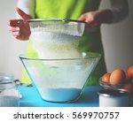 flour sifting through a sieve... | Shutterstock . vector #569970757