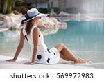 shot of a young woman relaxing... | Shutterstock . vector #569972983
