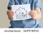 Small photo of Child holding drawing of house with family, closeup. Adoption concept