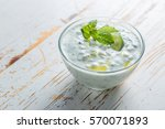 tzatziki sauce and ingredients... | Shutterstock . vector #570071893