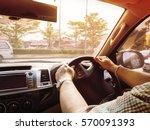 man control steering wheel with ... | Shutterstock . vector #570091393
