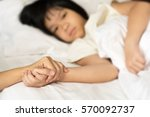 hands of mother and sick asian...   Shutterstock . vector #570092737