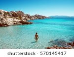 woman stands in crystal clear... | Shutterstock . vector #570145417