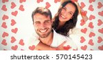 man doing piggy back to... | Shutterstock . vector #570145423