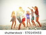 Friends Dancing At Beach On...