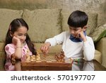boy and girl play chess | Shutterstock . vector #570197707