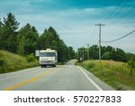 old rv on a road trip | Shutterstock . vector #570227833