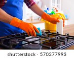 man makes cleaning the kitchen. ... | Shutterstock . vector #570277993