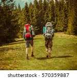 two young man hiking in forest... | Shutterstock . vector #570359887