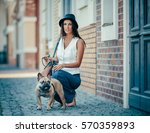 stylish young woman walking... | Shutterstock . vector #570359893