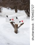 snow covered mailboxes in a...   Shutterstock . vector #570402727