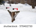 snow covered mailboxes in a...   Shutterstock . vector #570402733
