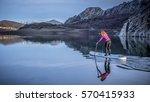 paddle surf lake | Shutterstock . vector #570415933