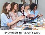 group of interior designers... | Shutterstock . vector #570451297