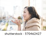 young woman talking on smart... | Shutterstock . vector #570462427