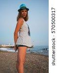 Small photo of beautiful woman on the beach at Alania, Turkey