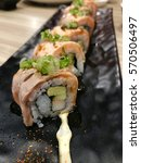 sushi roll with grilled smoke... | Shutterstock . vector #570506497