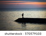 Fishermen Fish At Sunset On Th...