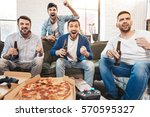 happy jubilant men expressing... | Shutterstock . vector #570595327