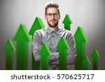 Smiling Businessman With Green...